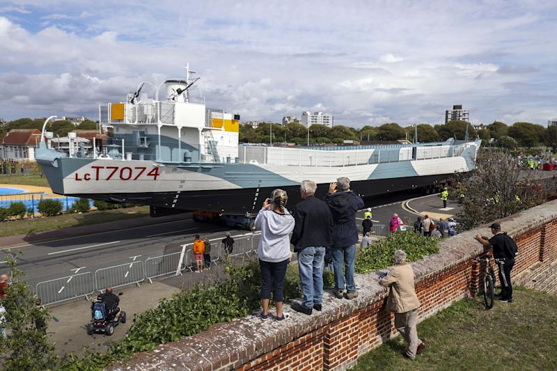 Restored World War Two landing craft LCT 7074 is transported from from the Naval Base in Portsmouth to its final resting place at the D-Day Story at Southsea.