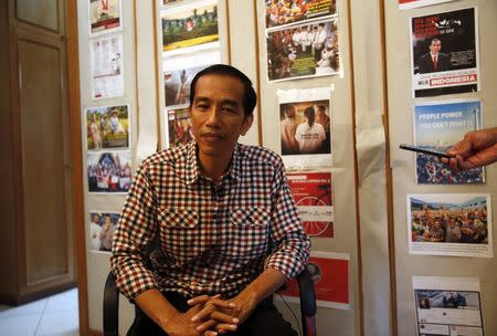 """Indonesia presidential candidate Joko """"Jokowi"""" Widodo listens to a question during an interview with Reuters in"""