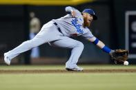 Los Angeles Dodgers third baseman Justin Turner makes a diving stop on a grounder hit by Arizona Diamondbacks' Carson Kelly before throwing to first base for the out during the eighth inning of a baseball game Saturday, Sept. 25, 2021, in Phoenix. The Diamondbacks defeated the Dodgers 7-2. (AP Photo/Ross D. Franklin)