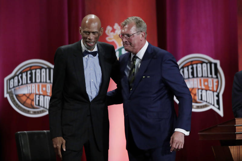 Inductee Jack Sikma, right, stands with presenter Kareem Abdul-Jabbar at the Basketball Hall of Fame enshrinement ceremony Friday, Sept. 6, 2019, in Springfield, Mass. (AP Photo/Elise Amendola)