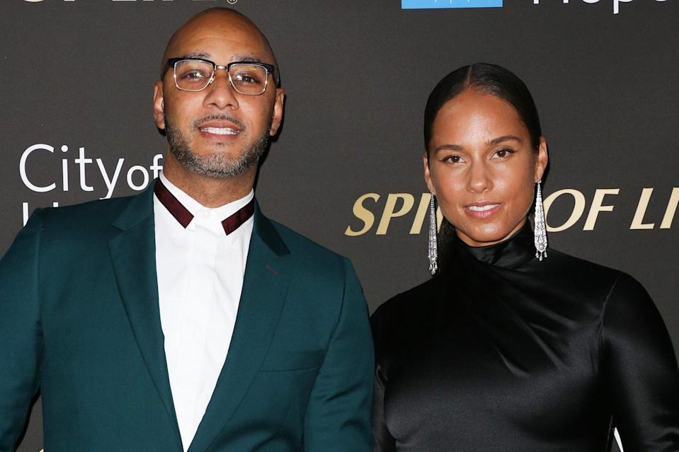 """<p>The singer <a href=""""https://people.com/celebrity/first-photo-alicia-keys-and-swizz-beatz-seal-marriage-with-a-kiss/"""" rel=""""nofollow noopener"""" target=""""_blank"""" data-ylk=""""slk:went for total goddess vibes in a Grecian-inspired white gown"""" class=""""link rapid-noclick-resp"""">went for total goddess vibes in a Grecian-inspired white gown</a> and jeweled headpiece when she wed producer Swizz Beatz in a private home on the Mediterranean in 2010. (<a href=""""https://people.com/music/alicia-keys-swizz-beatz-love-story-details/"""" rel=""""nofollow noopener"""" target=""""_blank"""" data-ylk=""""slk:See it here"""" class=""""link rapid-noclick-resp"""">See it here</a>.)</p>"""