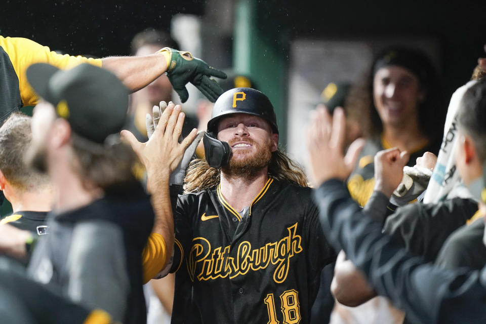 Pittsburgh Pirates' Ben Gamel (18) celebrates with teammates after hitting a home run during the fourth inning of a baseball game against the Cincinnati Reds in Cincinnati, Tuesday, Sept 21, 2021. (AP Photo/Bryan Woolston)