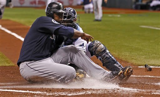 Tampa Bay Rays catcher Jose Lobaton, right, tags out Seattle Mariners' Carlos Peguero on a ball that lined off of starting pitcher Alex Cobb's leg during the second inning of a baseball game Saturday, July 21, 2012, in St. Petersburg, Fla. Cobb made the throw home and then left the game with an injury. (AP Photo/Mike Carlson)