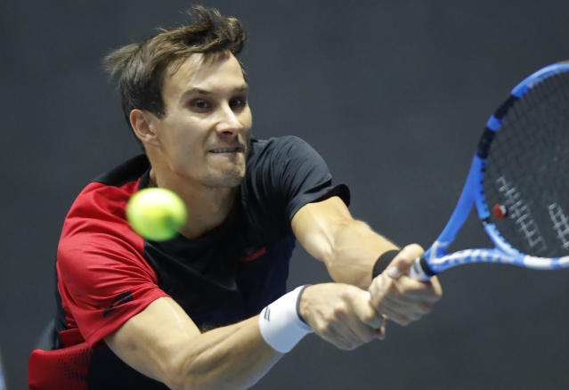 Evgeny Donskoy of Russia returns the ball to Daniil Medvedev of Russia during the St. Petersburg Open ATP tennis tournament match in St.Petersburg, Russia, Thursday, Sept. 19, 2019. (AP Photo/Dmitry Lovetsky)
