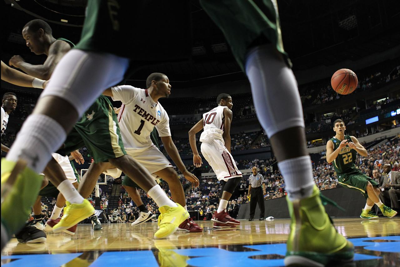 NASHVILLE, TN - MARCH 16:  Shaun Noriega #22 of the South Florida Bulls gets passed to against the Temple Owls during the second round of the 2012 NCAA Men's Basketball Tournament at Bridgestone Arena on March 16, 2012 in Nashville, Tennessee.  (Photo by Jamie Squire/Getty Images)