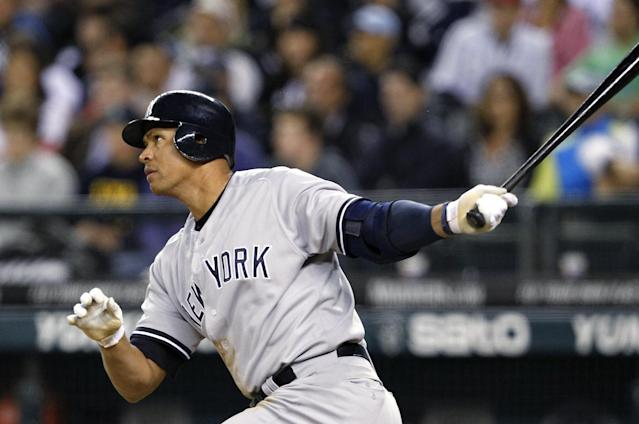 FILE - In this July 23, 2012, file photo, New York Yankees' Alex Rodriguez watches a home run against the Seattle Mariners in a baseball game in Seattle. A person familiar with the case tells The Associated Press Tuesday June 4, 2013 that the founder of a Miami anti-aging clinic has agreed to talk to Major League Baseball about players linked to performance-enhancing drugs. Alex Rodriguez, Ryan Braun, Nelson Cruz and Melky Cabrera are among the players whose names have been tied to the clinic. (AP Photo/Elaine Thompson, File)
