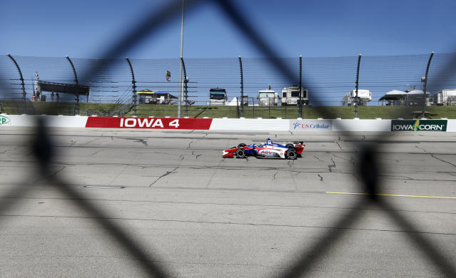 Tony Kanaan (14) drives his car during practice for the IndyCar Series auto race Saturday, July 7, 2018, at Iowa Speedway in Newton, Iowa. (AP Photo/Charlie Neibergall)
