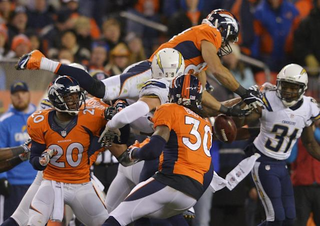 Denver Broncos wide receiver Eric Decker (87) leaps for an onside kick by thte San Diego Chargers in the fourth quarter of an NFL AFC division playoff football game, Sunday, Jan. 12, 2014, in Denver. San Diego recovered the kick on the play. (AP Photo/Jack Dempsey)