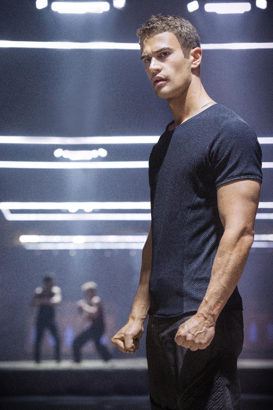 """This photo released by Summit Entertainment, LLC shows Theo James as Four in the film, """"Divergent."""" The movie releases on Friday, March 21, 2014. (AP Photo/Summit Entertainment, Jaap Buitendijk)"""