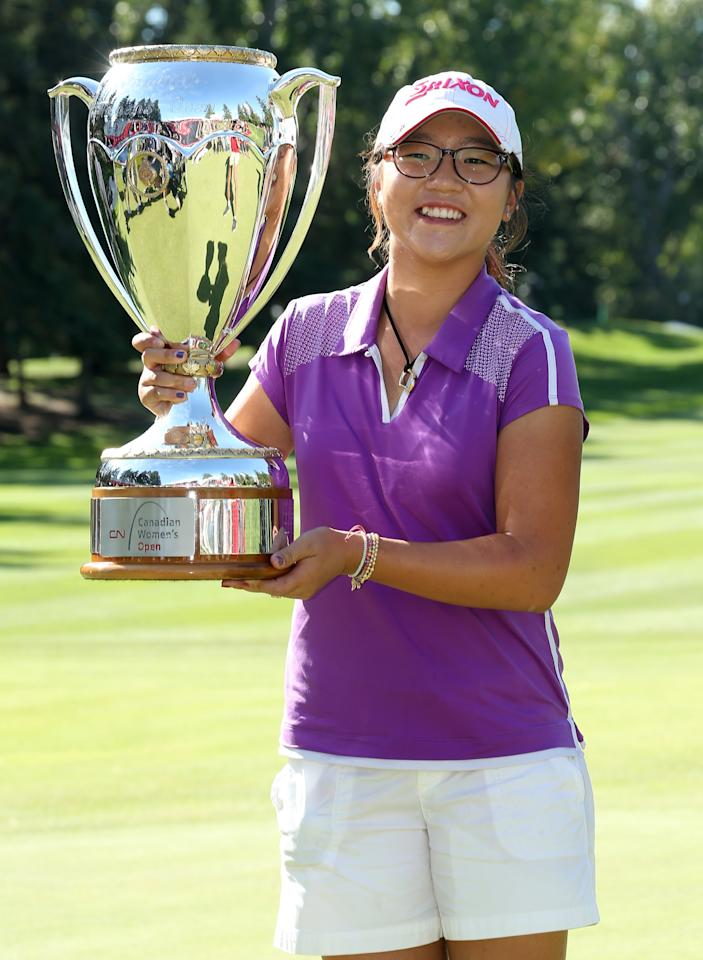 EDMONTON, AB - AUGUST 25: Lydia Ko of New Zealand poses with her trophy following her five stroke victory during the final round of the CN Canadian Women's Open at Royal Mayfair Golf Club on August 25, 2013 in Edmonton, Alberta, Canada. (Photo by Stephen Dunn/Getty Images)