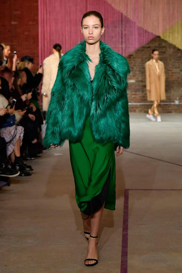 <p>Model wears an emerald fur coat and silk dress at the Milly Fall/Winter 2018 show. (Photo: Courtesy of Greg Kessler) </p>