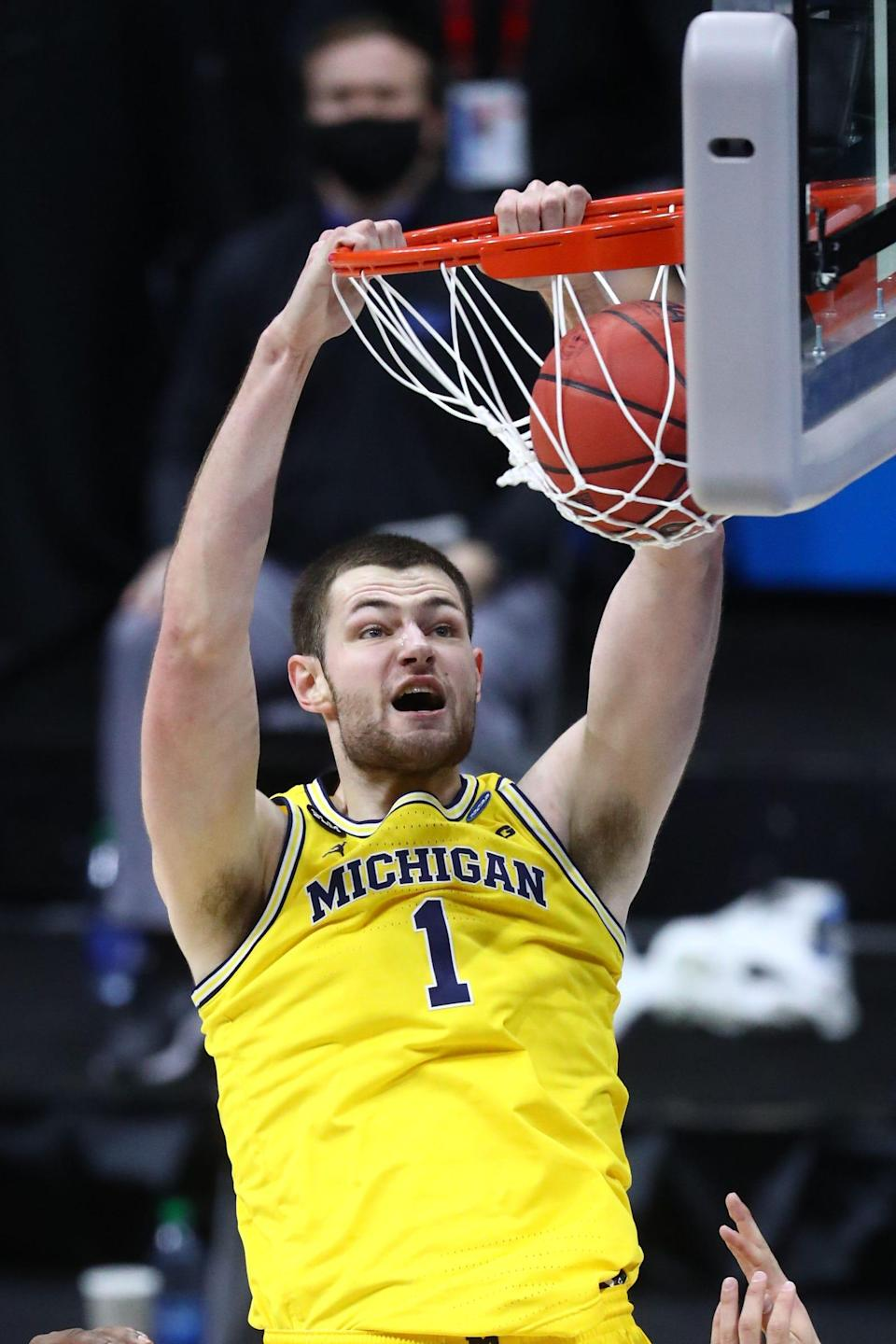 Michigan center Hunter Dickinson dunks the ball during the first half of the Elite Eight of the 2021 tournament on Tuesday, March 30, 2021, in Indianapolis.