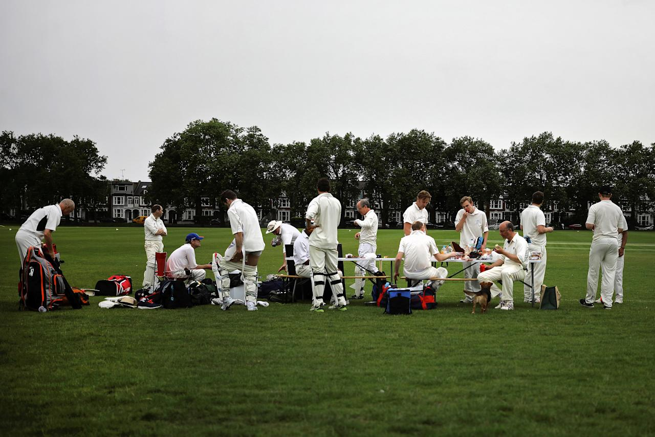 Members of a local cricket team stop for tea during their march in Barnes West London, Britain May 28, 2017.    REUTERS/Kevin Coombs     TPX IMAGES OF THE DAY