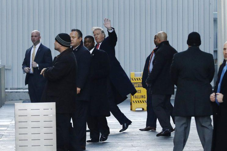 Trump exits One World Trade Center following a meeting in New York City on Friday. (Lucas Jackson/Reuters)