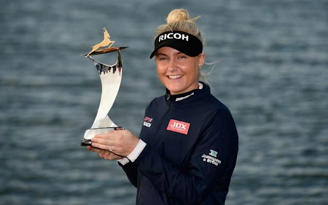 Charley Hull poses with her trophy after taking the win in Abu Dhabi - Getty Images Europe