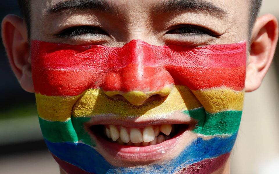 A participant with a rainbow painted on their face attends the annual Taiwan Pride March in Taipei, Taiwan - RITCHIE B TONGO/EPA-EFE/Shutterstock