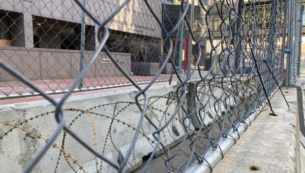 The Hennepin County courthouse and many federal buildings in Minneapolis are barricaded and surrounded by concertina wire ahead of the trial.
