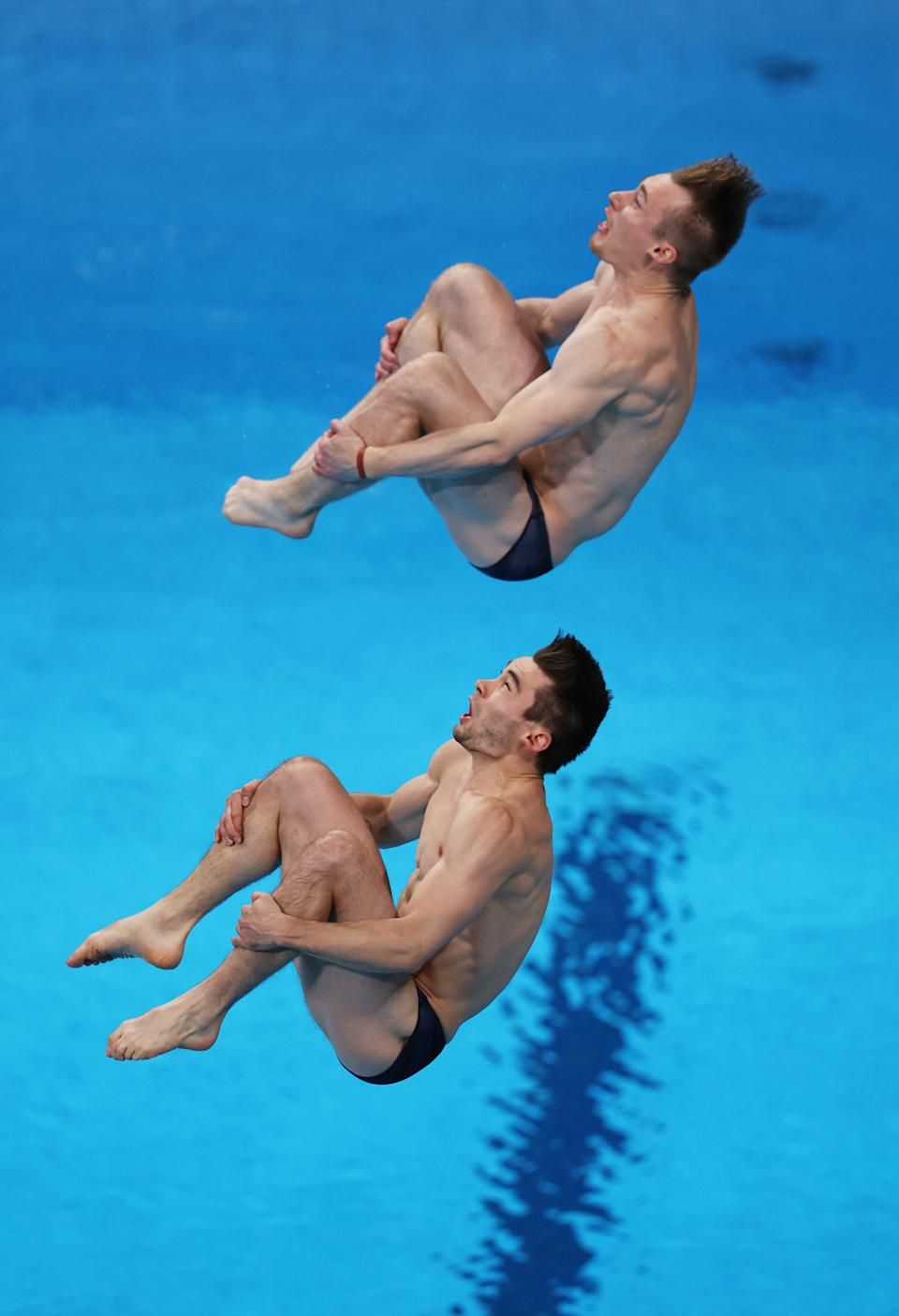 <p>TOKYO, JAPAN - JULY 28: Daniel Goodfellow and Jack Laugher of Team Great Britain compete during the Men's Synchronised 3m Springboard final on day five of the Tokyo 2020 Olympic Games at Tokyo Aquatics Centre on July 28, 2021 in Tokyo, Japan. (Photo by Tom Pennington/Getty Images)</p>