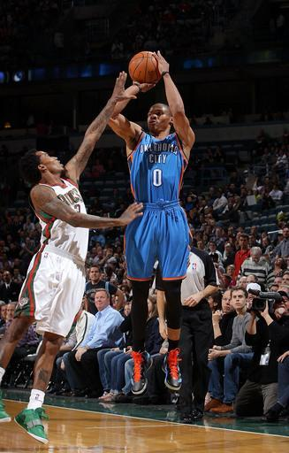 MILWAUKEE, WI - APRIL 9: Russell Westbrook #0 of the Oklahoma City Thunder shoots against Brandon Jennings #3 of the Milwaukee Bucks on April 9, 2012 at the Bradley Center in Milwaukee, Wisconsin. (Photo by Gary Dineen/NBAE via Getty Images)