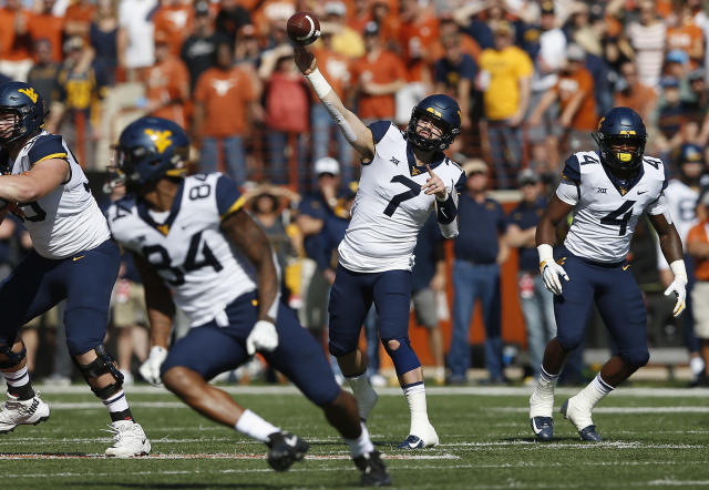 Will Grier threw for three TDs against Texas. (Getty)