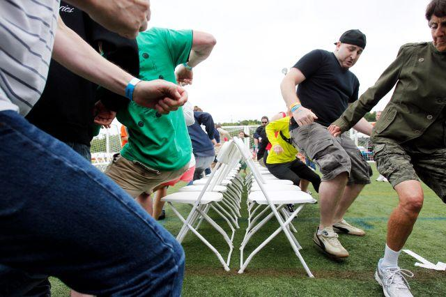 Contestants race to find a chair as the music stops during the Musical Chairs World Championship in Amesbury