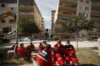 Member of rescue services take a break during search operations in the debris of a collapsed building for survivors in Izmir, Turkey, Sunday, Nov. 1, 2020. Rescue teams continue ploughing through concrete blocs and debris of collapsed buildings in Turkey's third largest city in search of survivors of a powerful earthquake that struck Turkey's Aegean coast and north of the Greek island of Samos, Friday Oct. 30, killing dozens Hundreds of others were injured.(AP Photo/Emrah Gurel)