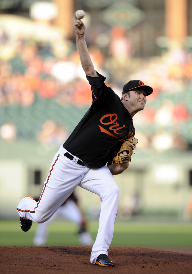Baltimore Orioles starting pitcher Chris Tillman delivers against the Boston Red Sox during the first inning of a baseball game on Friday, July 26, 2013, in Baltimore. (AP Photo/Nick Wass)