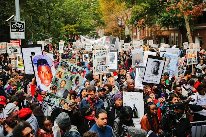 """Protesters take part in a march against police brutality called """"Rise up October"""" on October 24, 2015, in New York (AFP Photo/Eduardo Munoz Alvarez)"""