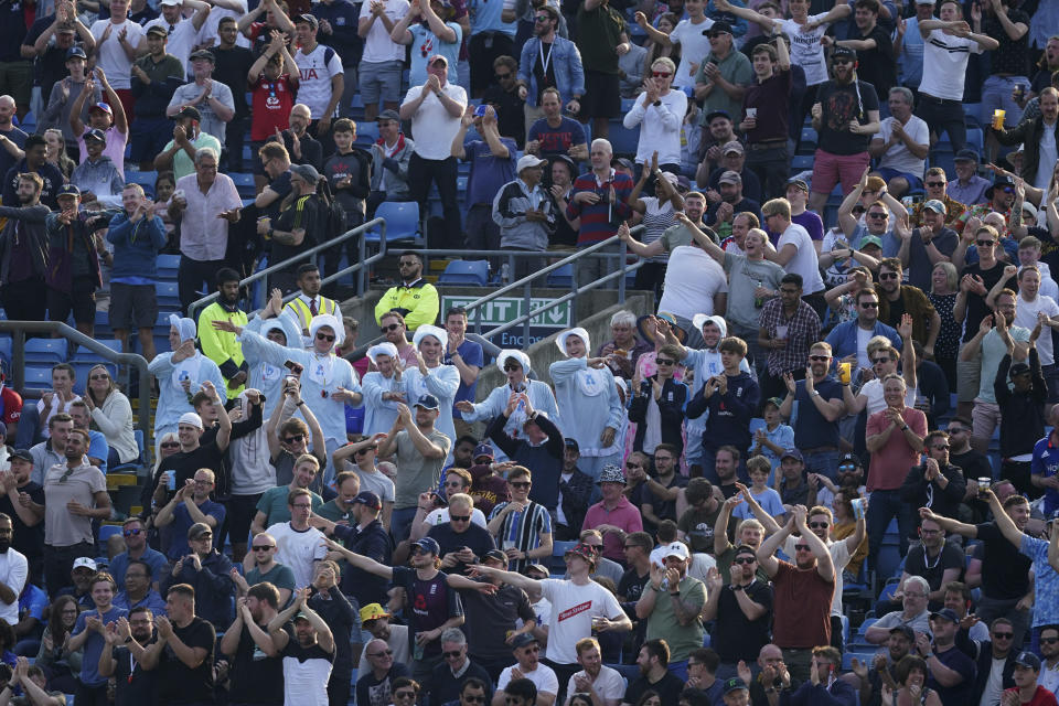 England supporters cheer for their team during the first day of third test cricket match between England and India, at Headingley cricket ground in Leeds, England, Wednesday, Aug. 25, 2021. (AP Photo/Jon Super)