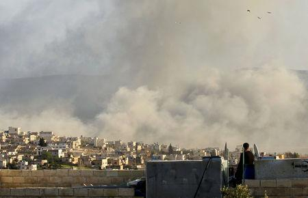 FILE PHOTO: Smoke rises after what activists said was an air strike on Atimah
