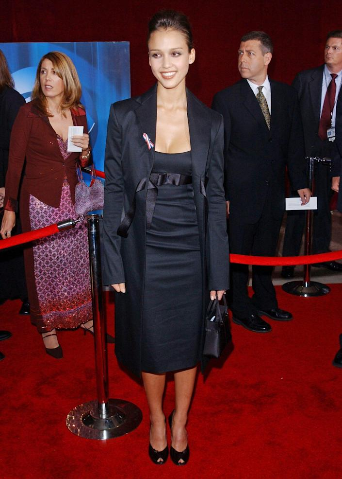 <p>Business as usual! Jessica Alba went with an all-black, buttoned-up ensemble for the red carpet. </p>