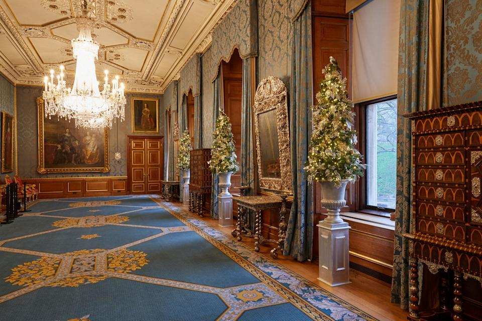 <p>Several smaller Christmas trees line the Queen's Gallery at Windsor Castle</p>PA