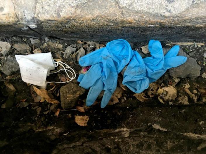 From Baghdad to Gaza, the disposable masks and gloves that remain in high demand to protect populations from the coronavirus pandemic are discarded after use, adding to pollution (AFP Photo/PATRICK BAZ)