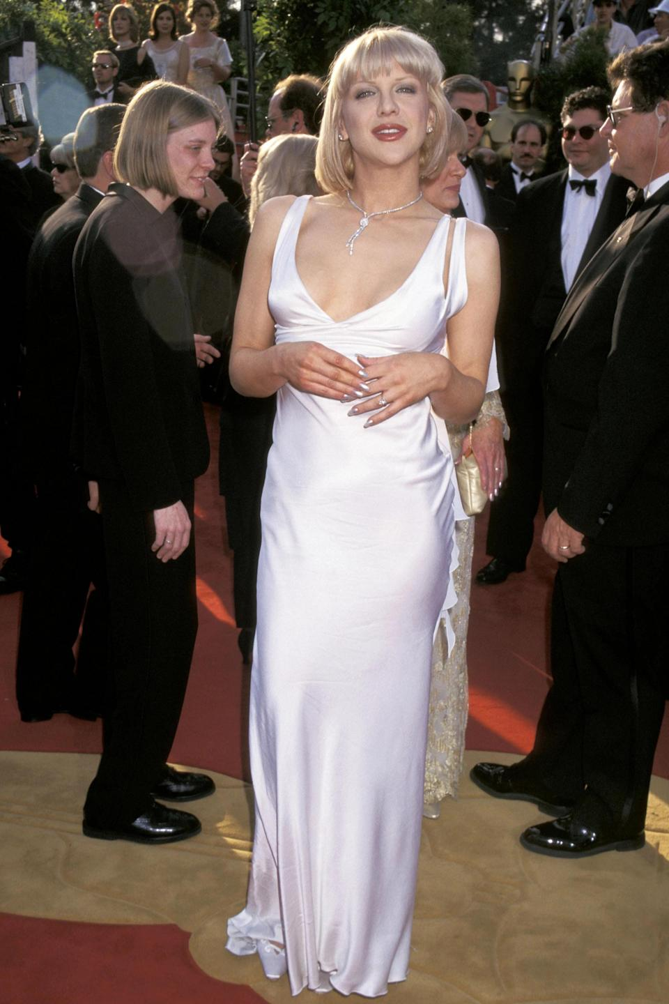 """<strong><h2>Courtney Love, 1997</h2></strong><br>The queen of grunge got all dolled up by Versace for the 1997 Academy Awards — and we support it 100%.<br><br><em>Courtney Love in Versace. </em><span class=""""copyright"""">Photo: Jim Smeal/WireImage/Getty Images. </span>"""