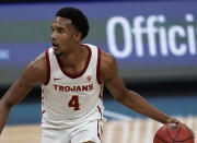 FILE - In this March 11, 2021, file photo, Southern California's Evan Mobley plays against Utah in an NCAA college basketball game in the quarterfinal round of the Pac-12 men's tournament in Las Vegas. Mobley is the headliner among big men in this year's NBA draft. (AP Photo/John Locher, File)