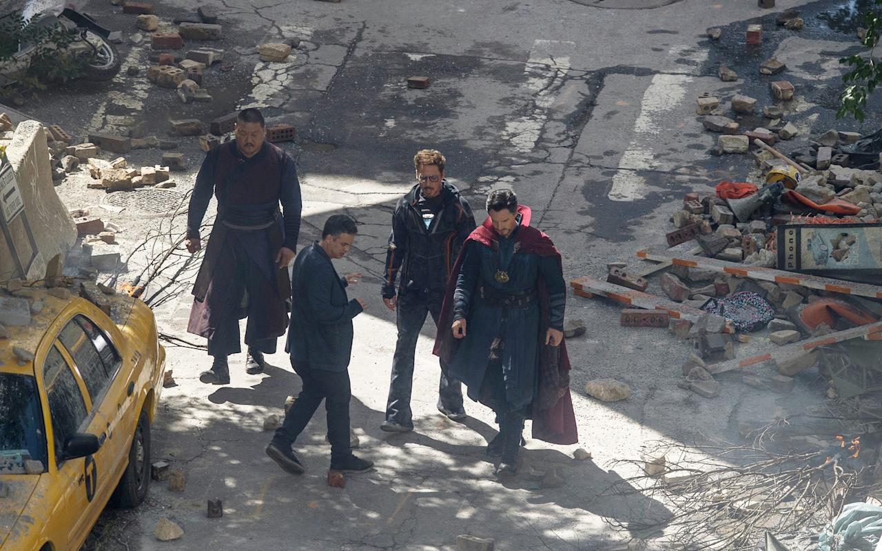 <p>Iron Man and Doctor Strange meet for the first time in the rubble (Credit: AP Photo/Mike Stewart) </p>