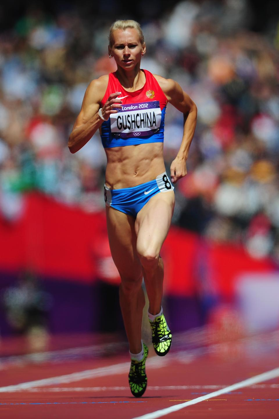 LONDON, ENGLAND - AUGUST 03: Yulia Gushchina of Russia competes in the Women's 400m Heats on Day 7 of the London 2012 Olympic Games at Olympic Stadium on August 3, 2012 in London, England. (Photo by Stu Forster/Getty Images)