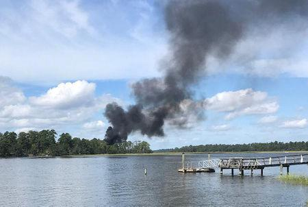 Smoke rises at the site of a F-35 jet crash in Beaufort, South Carolina, U.S., September 28, 2018 in this still image obtained from social media. KENSLEY MINCEY CROSBY/via REUTERS