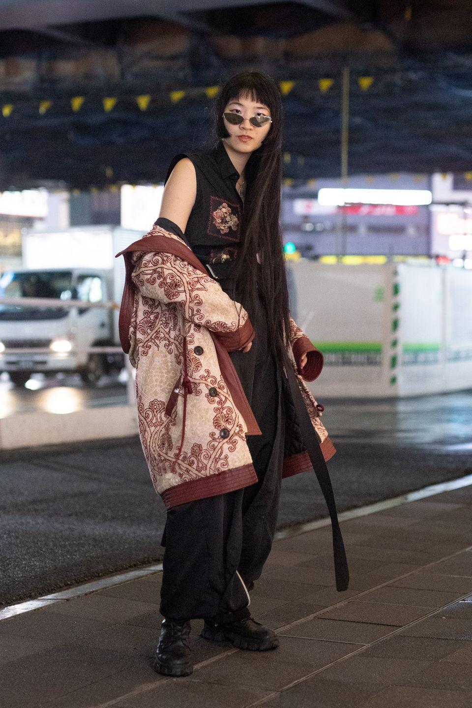 """<p>Take notes from the Tokyo street style set and opt for an oversized statement jacket over an all-black ensemble. </p><p><strong>Get the look: Gucci</strong> GG-Check tweed jacket, $3,600, <a href=""""https://go.skimresources.com?id=74968X1525079&xs=1&url=https%3A%2F%2Fwww.neimanmarcus.com%2Fp%2Fgucci-gg-check-tweed-jacket-prod226720498%3Futm_source%3Dgoogle_shopping%26adpos%3D%26scid%3Dscplpsku190431373%26sc_intid%3Dsku190431373%26ecid%3DNMCS__GooglePLA%26gclid%3DCj0KCQjwreT8BRDTARIsAJLI0KKw4xEGYYkuvw_cfkRmse4tl7RzAnmdWWYwEqg80KMunqI5DyGtydcaAijIEALw_wcB%26gclsrc%3Daw.ds"""" rel=""""nofollow noopener"""" target=""""_blank"""" data-ylk=""""slk:neimanmarcus.com"""" class=""""link rapid-noclick-resp"""">neimanmarcus.com</a>.</p>"""