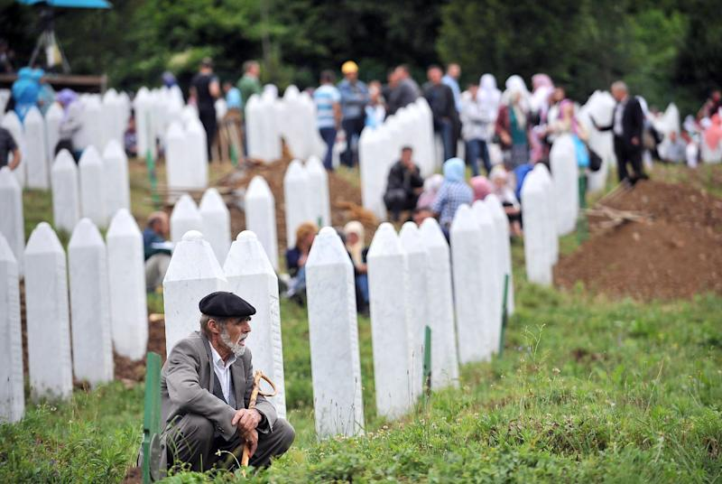 A Bosnian Muslim man, survivor of the Srebrenica 1995 massacre, pays his respects at a relative's grave at the Srebrenica-Potocari Genocide Memorial cemetery in the village of Potocari near the eastern-Bosnian town of Srebrenica on July 11, 2014 (AFP Photo/Elvis Barukcic)
