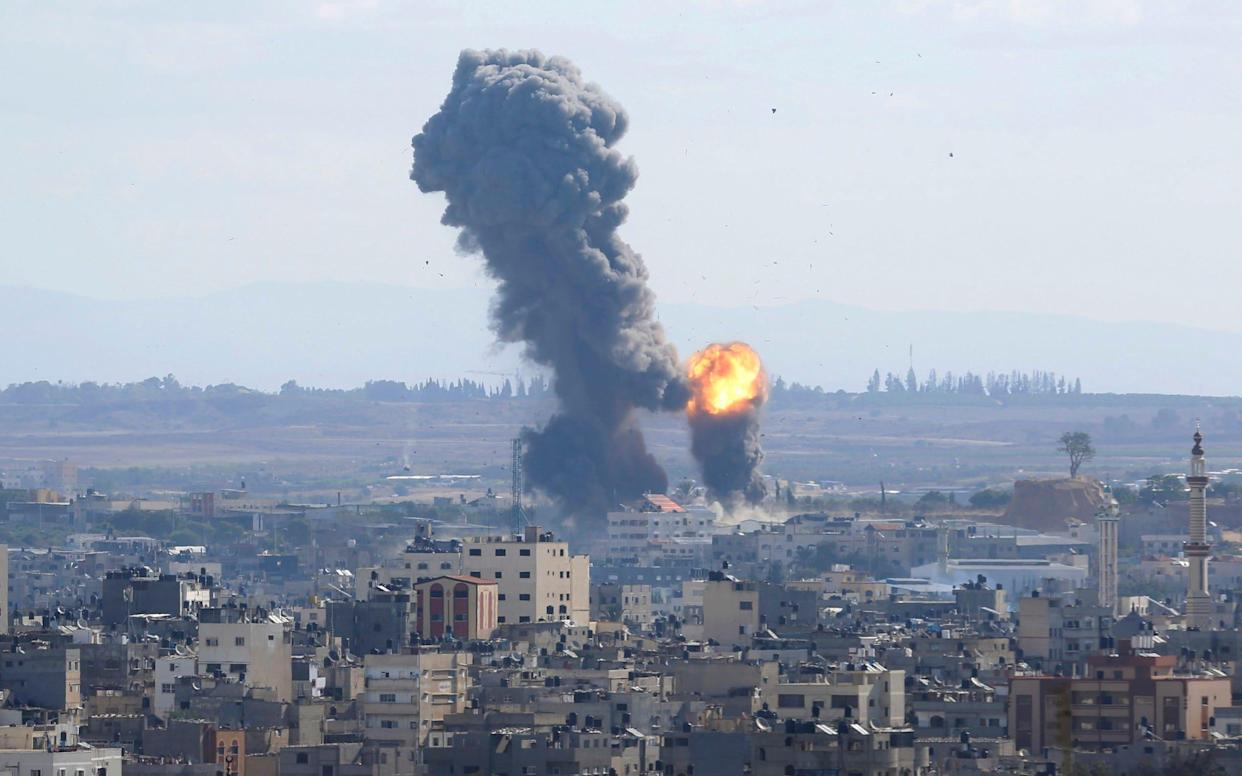 Smoke rises from an explosion caused by an Israeli airstrike in Gaza City, - AP