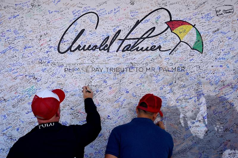 Fans sign a tribute wall for American golfer Arnold Palmer at Hazeltine National Golf Course ahead of the 41st Ryder Cup at Hazeltine National Golf Course in Chaska, Minnesota (AFP Photo/Jim Watson)