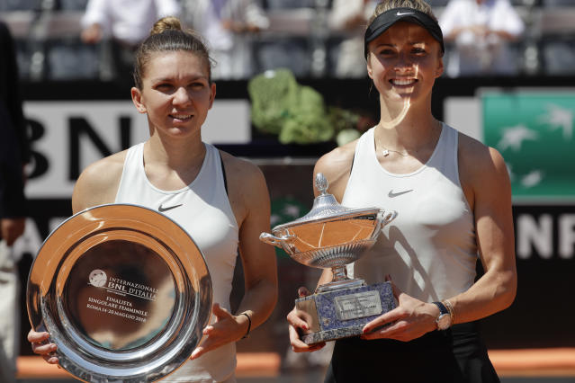 First placed, Ukraine's Elina Svitolina, right, and second placed Romania's Simona Halep pose for photographers at the end of their final match at the Italian Open tennis tournament, in Rome, Sunday, May 20, 2018. Svitolina won 6-0, 6-4. (AP Photo/Gregorio Borgia)