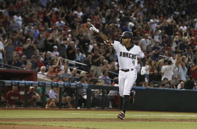 Arizona Diamondbacks shortstop Ketel Marte celebrates his home run against the Boston Red Sox during the fourth inning of a baseball game Friday, April 5, 2019, in Phoenix. (AP Photo/Ross D. Franklin)