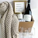 """<p><strong>Ready Festive</strong></p><p>wine.com</p><p><strong>$119.99</strong></p><p><a href=""""https://go.redirectingat.com?id=74968X1596630&url=https%3A%2F%2Fwww.wine.com%2Fproduct%2F92-point-pinot-noir-and-wine-decor-gift-set-by-readyfestive%2F737377&sref=https%3A%2F%2Fwww.cosmopolitan.com%2Flifestyle%2Fg37682336%2Fbest-wine-gift-baskets%2F"""" rel=""""nofollow noopener"""" target=""""_blank"""" data-ylk=""""slk:Shop Now"""" class=""""link rapid-noclick-resp"""">Shop Now</a></p><p>Yes, the blanket *comes with* the box so by giving this, you're basically saying """"please invite me over for a <em>Gilmore Girls </em>marathon.""""</p>"""