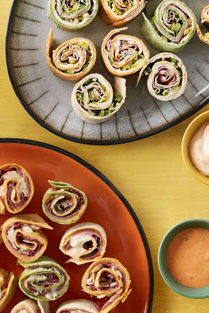 """<p>Sandwich rolls aren't just for kids, you know. These playful appetizers will delight all the grown-ups at your bash too.</p><p><strong><a href=""""https://www.thepioneerwoman.com/food-cooking/recipes/a34239402/make-ahead-sandwich-rolls/"""" rel=""""nofollow noopener"""" target=""""_blank"""" data-ylk=""""slk:Get the recipe"""" class=""""link rapid-noclick-resp"""">Get the recipe</a>.</strong></p><p><strong><a class=""""link rapid-noclick-resp"""" href=""""https://go.redirectingat.com?id=74968X1596630&url=https%3A%2F%2Fwww.walmart.com%2Fbrowse%2Fhome%2Fserveware%2Fthe-pioneer-woman%2F4044_623679_639999_2347672%2FYnJhbmQ6VGhlIFBpb25lZXIgV29tYW4ie&sref=https%3A%2F%2Fwww.thepioneerwoman.com%2Ffood-cooking%2Fmeals-menus%2Fg36004463%2Fmemorial-day-appetizers%2F"""" rel=""""nofollow noopener"""" target=""""_blank"""" data-ylk=""""slk:SHOP SERVEWARE"""">SHOP SERVEWARE</a></strong></p>"""