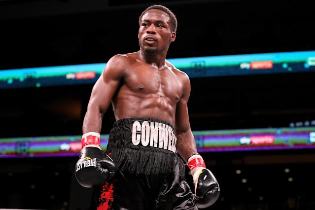 "Charles Conwell reacts after knocking out <a class=""link rapid-noclick-resp"" href=""/ncaaf/players/306757/"" data-ylk=""slk:Patrick Day"">Patrick Day</a> in the 10th round of their Super-Welterweight bout at Wintrust Arena. (Photo by Dylan Buell/Getty Images)"