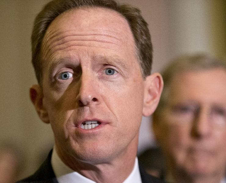 FILE - In this July 30, 2013 file photo, Sen. Pat Toomey, R-Pa. speaks with reporters on Capitol Hill in Washington. Flood insurance rate increases for hundreds of thousands of people would be put off under a bill that's steaming toward passage in the Senate, powered by coastal lawmakers telling horror stories of constituents at risk of losing their homes with the implementation of an overhaul of the federal flood insurance program passed less than two years ago. The Senate measure to delay some of the changes is likely to pass after votes on a host of amendments, including a plan by Toomey to phase in rate increases more slowly. It was unclear whether the measure will pass on Wednesday or Thursday. (AP Photo/J. Scott Applewhite, File)
