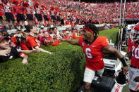 Georgia running back Kenny McIntosh (6) celebrates with the fans after defeating Arkansas in an NCAA college football game Saturday, Oct. 2, 2021, in Athens, Ga.. (AP Photo/John Bazemore)