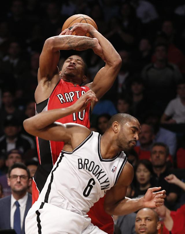 Toronto Raptors guard DeMar DeRozan (10) loses the ball after being fouled by Brooklyn Nets forward Alan Anderson (6) in the first half of Game 4 of an NBA basketball first-round playoff series on Sunday, April 27, 2014, in New York. (AP Photo/Kathy Willens)